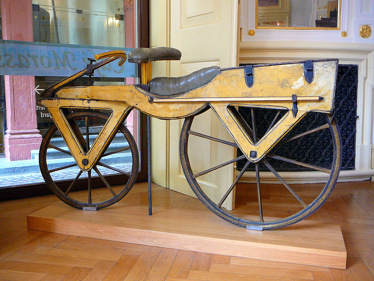 two wheeled wooden bicycle