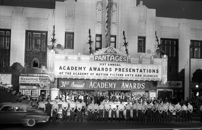 venue of the 31st academy awards ceremony with people standing in front