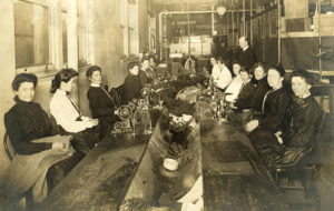 Photo showing first-ever sewing women, seamstresses in 1904 England.