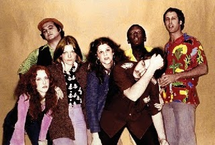 The original 1975 cast, from left to right: Laraine Newman, John Belushi, Jane Curtin, Gilda Radner, Dan Aykroyd, Garrett Morris, and Chevy Chase